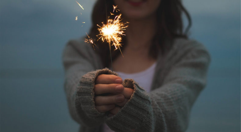 A girl with a spark. Is it a creative spark?