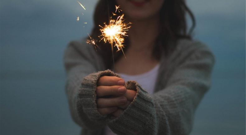 A girl with a spark. Is it a creative spark?