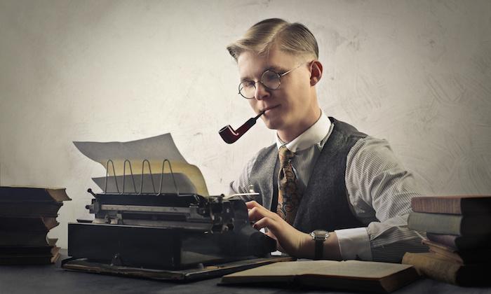 A writer using a typewriter